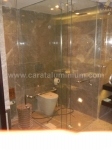 ALL-GLASS SHOWER ENCLOSURE AND TOILET CUBICLE